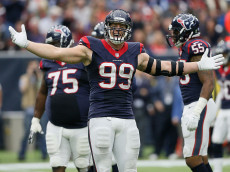 HOUSTON, TX - NOVEMBER 22:  J.J. Watt #99 of the Houston Texans gets the crowd into the against the New York Jets at NRG Stadium on November 22, 2015 in Houston, Texas.  (Photo by Bob Levey/Getty Images)