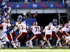 EAST RUTHERFORD, NJ - SEPTEMBER 25:   Dustin Hopkins #3 of the Washington Redskins kicks the game winning field goal against the New York Giants at MetLife Stadium on September 25, 2016 in East Rutherford, New Jersey.The Washington Redskins defeated the New York Giants 29-27.  (Photo by Elsa/Getty Images)