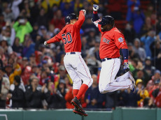 BOSTON, MA - SEPTEMBER 30:  David Ortiz #34 of the Boston Red Sox celebrates with Mookie Betts #50 after hitting a two run homer against the Toronto Blue Jays during the seventh inning at Fenway Park on September 30, 2016 in Boston, Massachusetts.  (Photo by Maddie Meyer/Getty Images)