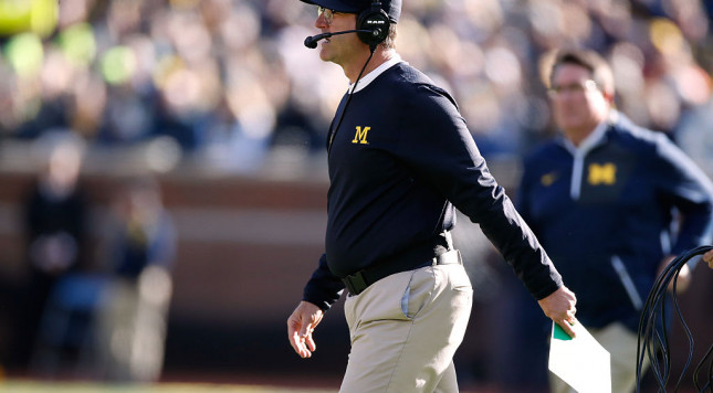 Jim Harbaugh goes with the Woody Hayes-Malcolm X-Michael Douglas look