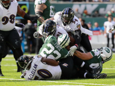 EAST RUTHERFORD, NJ - OCTOBER 23:  Matt Forte #22 of the New York Jets is tackled by the Baltimore Ravens defense during the first quarter of the game at MetLife Stadium on October 23, 2016 in East Rutherford, New Jersey.  (Photo by Michael Reaves/Getty Images)
