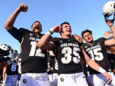 BOULDER, CO - OCTOBER 1:  Colorado Buffaloes players, including, from left, quarterback Steven Montez #12, running back Beau Bisharat #35, and place kicker Chris Graham #15, sing the fight song after a 47-6 win over the Oregon State Beavers at Folsom Field on October 1, 2016 in Boulder, Colorado.  (Photo by Dustin Bradford/Getty Images)