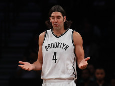 NEW YORK, NY - OCTOBER 13:  Luis Scola #4 of the Brooklyn Nets reacts during the first half of the game against the Boston Celtics at Barclays Center on October 13, 2016 in New York City. NOTE TO USER: User expressly acknowledges and agrees that, by downloading and or using this photograph, User is consenting to the terms and conditions of the Getty Images License Agreement.  (Photo by Michael Reaves/Getty Images)