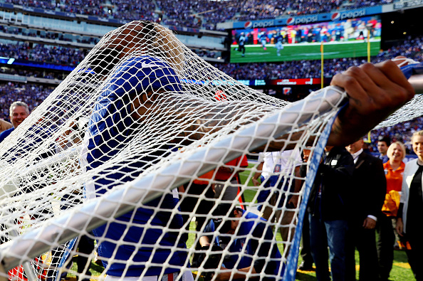 EAST RUTHERFORD, NJ - OCTOBER 16:  Odell Beckham #13 of the New York Giants sticks his head through the kicking net after scoring the go ahead touchdown against the Baltimore Ravens in the fourth quarter during their game at MetLife Stadium on October 16, 2016 in East Rutherford, New Jersey.  (Photo by Al Bello/Getty Images)