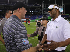 MIAMI, FL - DECEMBER 21: Head coach Jeff Brohm of the Western Kentucky Hilltoppers and head coach Willie Taggart of the South Florida Bulls shake hands following the 2015 Miami Beach Bowl at Marlins Park on December 21, 2015 in Miami, Florida. (Photo by Mike Ehrmann/Getty Images)