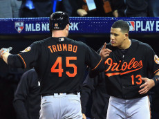 TORONTO, ON - OCTOBER 04: Mark Trumbo #45 of the Baltimore Orioles celebrates with Manny Machado #13 after hitting a two-run home run in the fourth inning against the Toronto Blue Jays during the American League Wild Card game at Rogers Centre on October 4, 2016 in Toronto, Canada. (Photo by Vaughn Ridley/Getty Images)