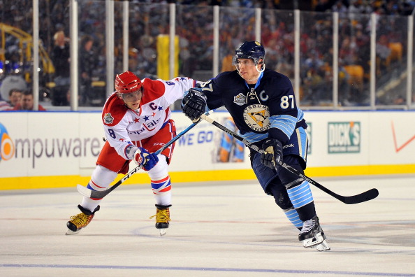 PITTSBURGH, PA - JANUARY 01:  Sidney Crosby #87 of the Pittsburgh Penguins skates against Alex Ovechkin #8 of the Washington Capitals during the 2011 NHL Bridgestone Winter Classic at Heinz Field on January 1, 2011 in Pittsburgh, Pennsylvania.  (Photo by Brian Babineau/NHLI via Getty Images)