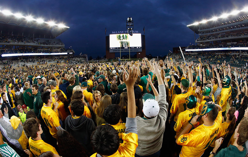 WACO, TX - OCTOBER 11:  Fans rush the field after the Baylor Bears beat the TCU Horned Frogs 61-58 at McLane Stadium on October 11, 2014 in Waco, Texas.  (Photo by Tom Pennington/Getty Images)