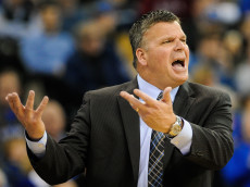 OMAHA, NEBRASKA - NOVEMBER 19: Head coach Greg McDermott of the Creighton Bluejays questions a foul call during their game against the Oklahoma Sooners at CenturyLink Center November 19, 2014 in Omaha, Nebraska. Creighton defeated upset Oklahoma 65-63.  (Photo by Eric Francis/Getty Images)