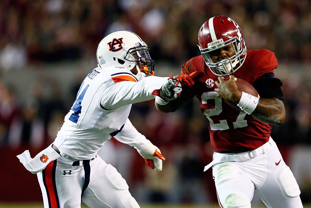 TUSCALOOSA, AL - NOVEMBER 29: Derrick Henry #27 of the Alabama Crimson Tide runs the ball in the fourth quarter against the Auburn Tigers during the Iron Bowl at Bryant-Denny Stadium on November 29, 2014 in Tuscaloosa, Alabama. (Photo by Kevin C. Cox/Getty Images)