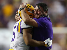 BATON ROUGE, LA - OCTOBER 01:  Derrius Guice #5 hugs head coach Ed Orgeron of the LSU Tigers after a touchdown against the Missouri Tigers at Tiger Stadium on October 1, 2016 in Baton Rouge, Louisiana.  (Photo by Chris Graythen/Getty Images)
