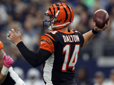 ARLINGTON, TX - OCTOBER 09:   Andy Dalton #14 of the Cincinnati Bengals drops back to pass during the first quarter against the Dallas Cowboys at AT&T Stadium on October 9, 2016 in Arlington, Texas. (Photo by Ronald Martinez/Getty Images)