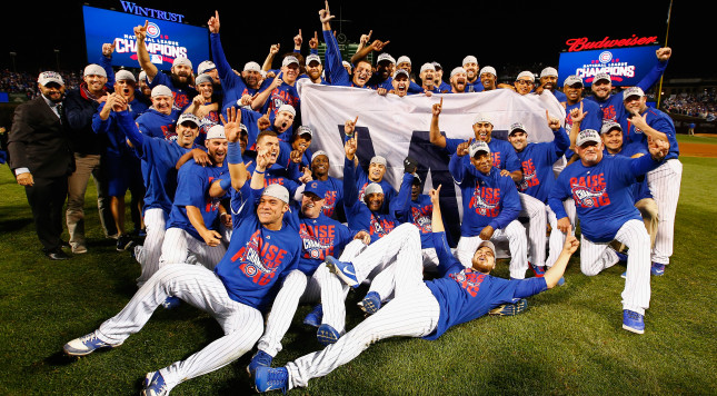 CHICAGO, IL - OCTOBER 22:  The Chicago Cubs pose after defeating the Los Angeles Dodgers 5-0 in game six of the National League Championship Series to advance to the World Series against the Cleveland Indians at Wrigley Field on October 22, 2016 in Chicago, Illinois.  (Photo by Jamie Squire/Getty Images)