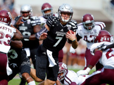 STARKVILLE, MS - NOVEMBER 5:  Quarterback Nick Fitzgerald #7 of the Mississippi State Bulldogs carries the ball during the first half of an NCAA college football game against the Texas A&M Aggies at Davis Wade Stadium on November 5, 2016 in Starkville, Mississippi. (Photo by Butch Dill/Getty Images)
