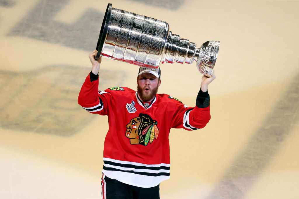 CHICAGO, IL - JUNE 15:  Bryan Bickell #29 of the Chicago Blackhawks celebrates by hoisting the Stanley Cup after defeating the Tampa Bay Lightning  by a score of 2-0 in Game Six to win the 2015 NHL Stanley Cup Final at the United Center  on June 15, 2015 in Chicago, Illinois.  (Photo by Jonathan Daniel/Getty Images)