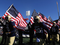 ANNAPOLIS, MD - NOVEMBER 12: Members of the Navy Midshipmen take the field before the start of their game against the Tulsa Golden Hurricane at Navy-Marine Corps Memorial Stadium on November 12, 2016 in Annapolis, Maryland.  (Photo by Rob Carr/Getty Images)