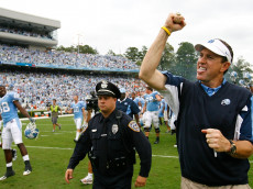 CHAPEL HILL, NC - OCTOBER 06:  Head coach Butch Davis of the North Carolina Tar Heels celebrates toward the student section after the Tar Heels 33-27 win over the Miami Hurricanes at Kenan Stadium on October 6, 2007 in Chapel Hill, North Carolina.  (Photo by Kevin C. Cox/Getty Images)