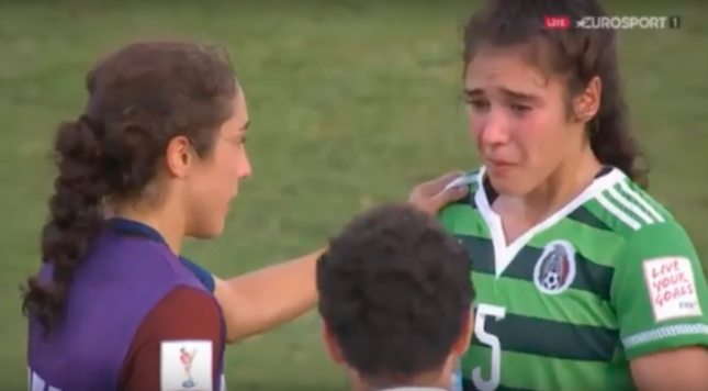 USA's Sabrina Flores consoles twin sister Monica after defeating rival Mexico