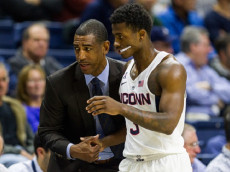 STORRS, CT - NOVEMBER 14: UConn Huskies Head Coach Kevin Ollie talks with UConn Huskies Guard Alterique Gilbert (3) at the bench during the first half of a men's NCAA division 1 basketball game between the Northeastern Huskies and the UConn Huskies on November 14, 2016, at the Harry A. Gampel Pavilion in Storrs, CT. (Photo by David Hahn/Icon Sportswire)