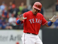 ARLINGTON, TX - OCTOBER 07: Ian Desmond #20 of the Texas Rangers reacts after hitting a double against the Toronto Blue Jays in the seventh inning of game two of the American League Divison Series at Globe Life Park in Arlington on October 7, 2016 in Arlington, Texas. (Photo by Ronald Martinez/Getty Images)