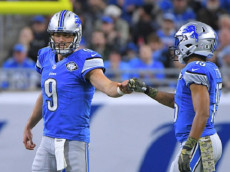 Detroit, MI - NOVEMBER 20: Detroit Lions quarterback Matthew Stafford (9) and Detroit Lions wide receiver Golden Tate (15) fist bump after getting first down during the NFL football game between the Jacksonville Jaguars and Detroit Lions on November 20, 2016, at Ford Field in Detroit, Michigan.  (Photo by Steven King/Icon Sportswire)