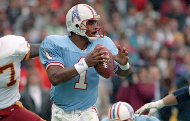 WASHINGTON, DC - NOVEMBER 3: Quarterback Warren Moon #1 of the Houston Oilers drops back to pass against the Washington Redskins at RFK Stadium on November 3, 1991 in Washington, DC. Washington defeated Houston 16-13. (Photo by George Gojkovich/Getty Images)
