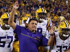 BATON ROUGE, LA - OCTOBER 22: Head coach Ed Orgeron of the LSU Tigers leads his team on the field before a game against the Mississippi Rebels at Tiger Stadium on October 22, 2016 in Baton Rouge, Louisiana.  (Photo by Jonathan Bachman/Getty Images)