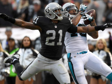 OAKLAND, CA - NOVEMBER 27: Kelvin Benjamin #13 of the Carolina Panthers catches a 44-yard pass for a touchdown pass over Sean Smith #21 of the Oakland Raiders during an NFL football game on November 27, 2016 at the Oakland-Alameda County Coliseum in Oakland, California. (Photo by Thearon W. Henderson/Getty Images)