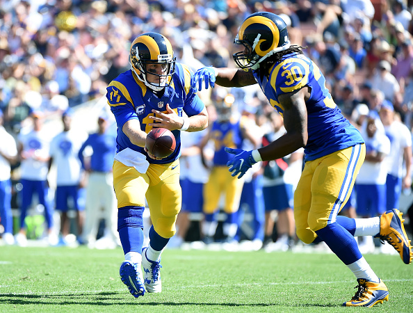 LOS ANGELES, CA - SEPTEMBER 18: Case Keenum #17 of the Los Angeles Rams hands off to Todd Gurley #30 during the fourth quarter of the home opening NFL game between the Los Angeles Rams and the Seattle Seahawks at Los Angeles Coliseum on September 18, 2016 in Los Angeles, California. (Photo by Harry How/Getty Images)