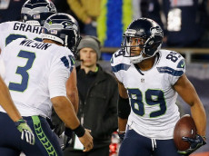 FOXBORO, MA - NOVEMBER 13: Doug Baldwin #89 of the Seattle Seahawks celebrates with Russell Wilson #3 after catching a touchdown pass during the second quarter of a game against the New England Patriots at Gillette Stadium on November 13, 2016 in Foxboro, Massachusetts. (Photo by Jim Rogash/Getty Images)