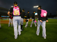 LOS ANGELES, CA - SEPTEMBER 16:  Rookie Pittsburgh Pirates pitchers wear children's backpacks in a hazing traditon as they head to the bullpen before the game with the Los Angeles Dodgers on September 16, 2011 at Dodger Stadium in Los Angeles, California.   (Photo by Stephen Dunn/Getty Images)