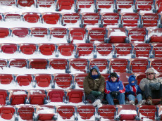EAST RUTHERFORD, NJ - DECEMBER 7:  Fans brave the cold weather at the New York Giants verses Washington Redskins game on December 7, 2003 at Giants Stadium in East Rutherford, New Jersey.  (Photo by Al Bello/Getty Images)