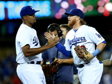 LOS ANGELES, CA - AUGUST 21:   Justin Turner #10 and closer Kenley Jansen #74 of the Los Angeles Dodgers celebrate after the game with the San Diego Padres at Dodger Stadium on August 21, 2014 in Los Angeles, California.  The Dodgers won 2-1.  (Photo by Stephen Dunn/Getty Images)