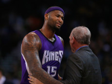 OAKLAND, CA - DECEMBER 28:  DeMarcus Cousins #15 of the Sacramento Kings is consoled by George Karl of the Sacramento Kings after being taken out of the game after he picked up his third foul against the Golden State Warriors at ORACLE Arena on December 28, 2015 in Oakland, California. NOTE TO USER: User expressly acknowledges and agrees that, by downloading and or using this photograph, User is consenting to the terms and conditions of the Getty Images License Agreement.  (Photo by Ezra Shaw/Getty Images)