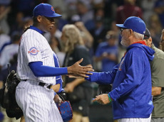 CHICAGO, IL - AUGUST 31: Manager Joe Maddon #70 of the Chicago Cubs shakes hands with Aroldis Chapman #54 after a win over the Pittsburgh Pirates at Wrigley Field on August 31, 2016 in Chicago, Illinois. The Cubs defeated the Pirates 6-5. (Photo by Jonathan Daniel/Getty Images)