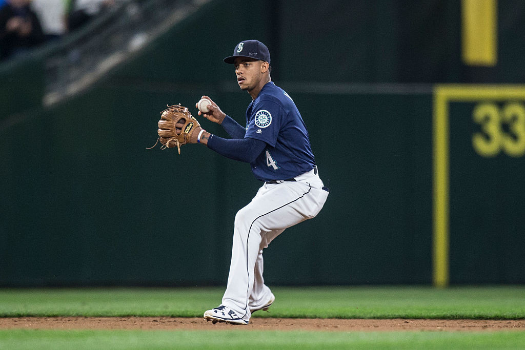 SEATTLE, WA - SEPTEMBER 30: Shortstop Ketel Marte #4 of the Seattle Mariners makes a throw to first base during a game against the Oakland Athletics at Safeco Field on September 30, 2016 in Seattle, Washington. The Mariners won the game 5-1. (Photo by Stephen Brashear/Getty Images)