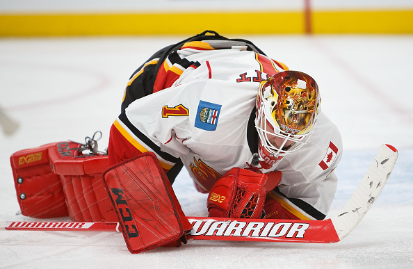 EDMONTON, AB - OCTOBER 12:  Goalie Brian Elliott #1 of the Calgary Flames covers up the puck while playing against the Edmonton Oilers on October 12, 2016 at Rogers Place in Edmonton, Alberta, Canada. (Photo by Codie McLachlan/Getty Images)