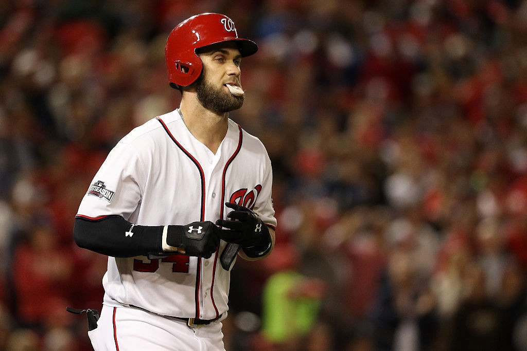 WASHINGTON, DC - OCTOBER 13: Bryce Harper #34 of the Washington Nationals runs to first after being walked by the Los Angeles Dodgers in the fifth inning during game five of the National League Division Series at Nationals Park on October 13, 2016 in Washington, DC. (Photo by Patrick Smith/Getty Images)