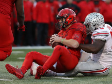 COLLEGE PARK, MD - NOVEMBER 12: Quarterback Caleb Rowe #7 of the Maryland Terrapins is sacked by defensive end Tyquan Lewis #59 of the Ohio State Buckeyes during the second quarter at Capital One Field at Maryland Stadium on November 12, 2016 in College Park, Maryland. (Photo by Patrick Smith/Getty Images)
