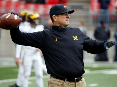COLUMBUS, OH - NOVEMBER 26:   Head coach Jim Harbaugh of the Michigan Wolverines participates in warmups with is team on the field prior to their game against the Ohio State Buckeyes at Ohio Stadium on November 26, 2016 in Columbus, Ohio.  (Photo by Gregory Shamus/Getty Images)