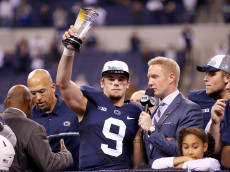INDIANAPOLIS, IN - DECEMBER 03: Trace McSorley #9 of the Penn State Nittany Lions holds up the Most Valuable Player Trophy during the post-game celebration after Penn State beat the Wisconsin Badgers 38-31 in the Big Ten Championship at Lucas Oil Stadium on December 3, 2016 in Indianapolis, Indiana.  (Photo by Joe Robbins/Getty Images)