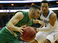NEWARK, NJ - DECEMBER 10: Matt Farrell #5 of the Notre Dame Fighting Irish drives to the basket as Jalen Brunson #1 of the Villanova Wildcats defends during the second half of a college basketball game at Prudential Center on December 10, 2016 in Newark, New Jersey. Villanova defeated Notre Dame 74-66. (Photo by Rich Schultz/Getty Images)
