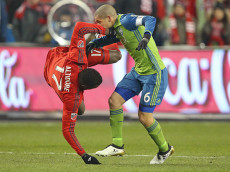 TORONTO, ONTARIO - DECEMBER 10:  Osvaldo Alonso #6 of the Seattle Sounders takes down Jozy Altidore #17 of the Toronto FC in the 2016 MLS Cup at BMO Field on December 10, 2016 in Toronto, Ontario, Canada. (Photo by Claus Andersen/Getty Images)