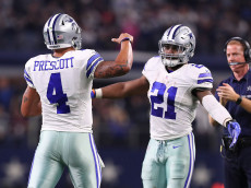 ARLINGTON, TX - DECEMBER 18:  Dak Prescott #4 and Ezekiel Elliott of the Dallas Cowboys celebrate after scoring a touchdown during the second quarter against the Tampa Bay Buccaneers at AT&T Stadium on December 18, 2016 in Arlington, Texas. (Photo by Tom Pennington/Getty Images)