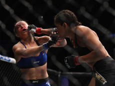 in their UFC women's bantamweight championship bout during the UFC 207 event on December 30, 2016 in Las Vegas, Nevada.