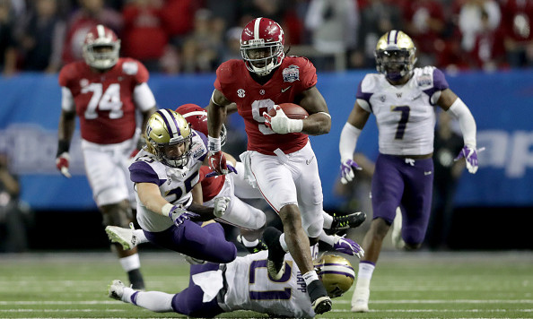 ATLANTA, GA - DECEMBER 31:  Bo Scarbrough #9 of the Alabama Crimson Tide runs the ball against the  Washington Huskies  during the 2016 Chick-fil-A Peach Bowl at the Georgia Dome on December 31, 2016 in Atlanta, Georgia.  (Photo by Streeter Lecka/Getty Images)