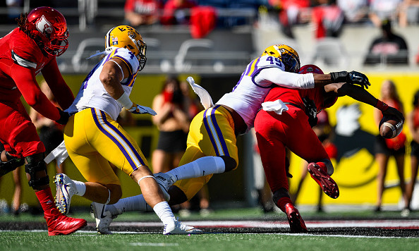 ORLANDO, FL - DECEMBER 31: LSU Tigers defensive end Arden Key (49) sacks University of Louisville Cardinals quarterback Lamar Jackson (8) in the end zone for safety during the first half of the Citrus Bowl game between the Louisville Cardinals and the LSU Tigers on December 31, 2016, at Camping World Stadium in Orlando, FL. (Photo by Roy K. Miller/Icon Sportswire via Getty Images).