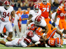 ATLANTA, GA - DECEMBER 03:  Jordan Scarlett #25 of the Florida Gators is tackled by Ryan Anderson #22, and Dalvin Tomlinson #54 of the Alabama Crimson Tide in the third quarter during the SEC Championship game at the Georgia Dome on December 3, 2016 in Atlanta, Georgia.  (Photo by Kevin C. Cox/Getty Images)