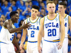 LOS ANGELES, CA - NOVEMBER 11:  Aaron Holiday #3 of the UCLA Bruins reacts to a dunk from Lonzo Ball #2 as TJ Leaf #22 and Bryce Alford #20 walk back during the first half against the Pacific Tigers at Pauley Pavilion on November 11, 2016 in Los Angeles, California.  (Photo by Harry How/Getty Images)