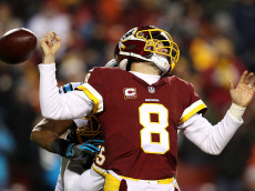 LANDOVER, MD - DECEMBER 19: Quarterback Kirk Cousins #8 of the Washington Redskins fumbles the ball in the third quarter against the Carolina Panthers at FedExField on December 19, 2016 in Landover, Maryland. (Photo by Patrick Smith/Getty Images)